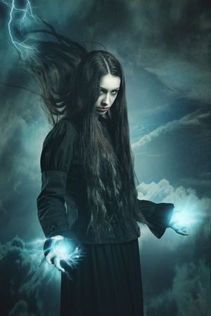 38479482 - dark witch calling thunder powers . fantasy and surreal studio shot