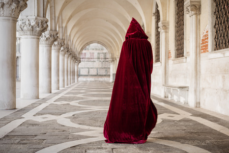 44148085 - mysterious woman in red cloak