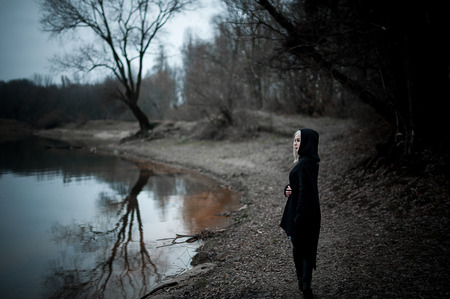 52888757 - shot of a gothic woman in a forest. fashion.