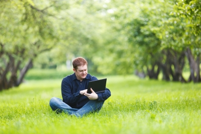 Man working with notebook in the park.