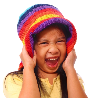 Happy Girl Having Great Fun And Wearing A Multicolored Hat